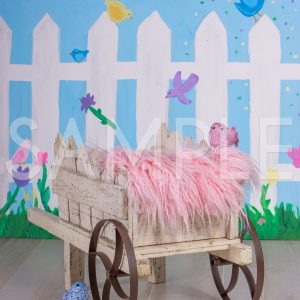 spring pink wagon wheel barrow garden backdrop